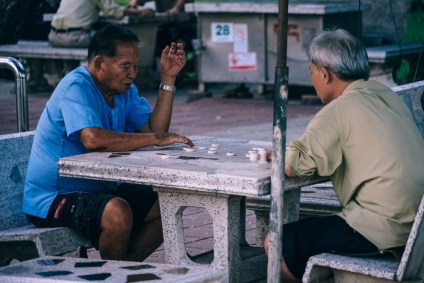 Old-Asian-Men-Playing-Checkers