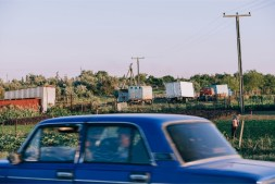 Old-Blue-Car-Driving-Around-a-Country-Side-in-Crimea