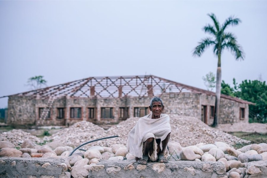 Old-Nepali-Man-Sitting-on-a-Rock