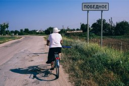 Older-Woman-Driving-a-Bicycle-in-a-Country-Side