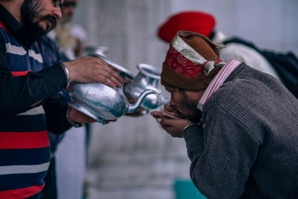 People-Drinking-Holy-Water-at-Gurudwara-Bangla-Sahib