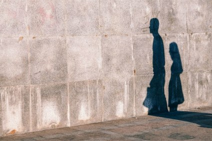 Shadows-of-a-Man-and-a-Woman-on-a-Stone-Wall