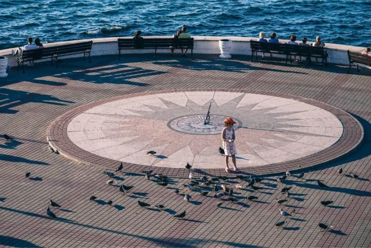 Small-Girl-Feeding-Pigeons