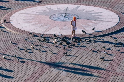 Small-Girl-Feeding-the-Birds-at-a-Square-in-Sevastopol
