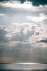 Sun-Shining-Through-Puffy-Clouds