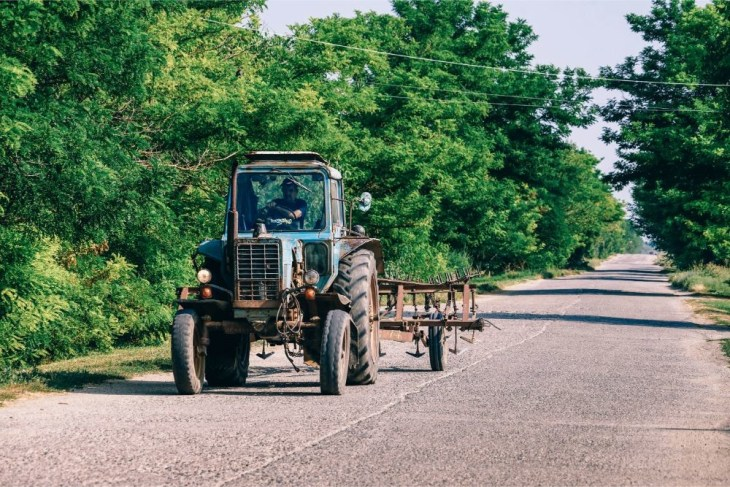 Tractor-Driving-Through-a-Russian-Country-Side-Road