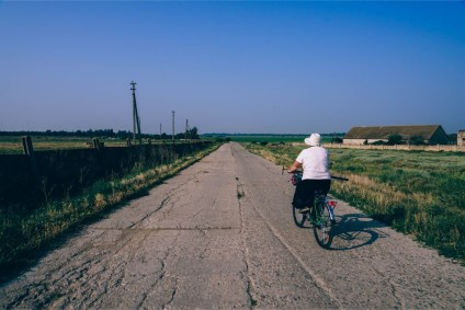Woman-Riding-a-Bike-in-a-Russian-Country-Side