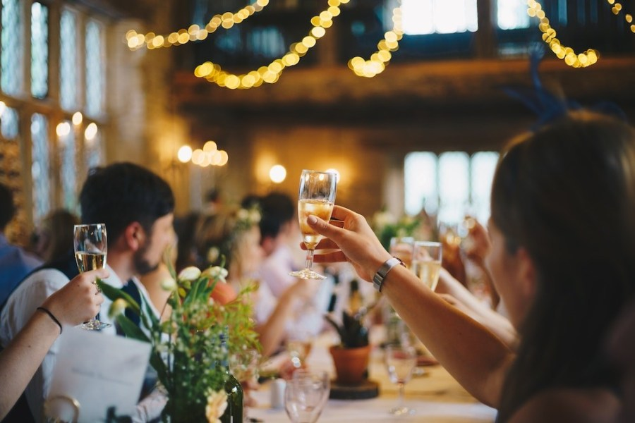 people-raising-wine-glass-in-selective-focus-photography