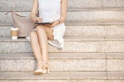 woman-using-app-on-digital-tablet-MNR7WX7