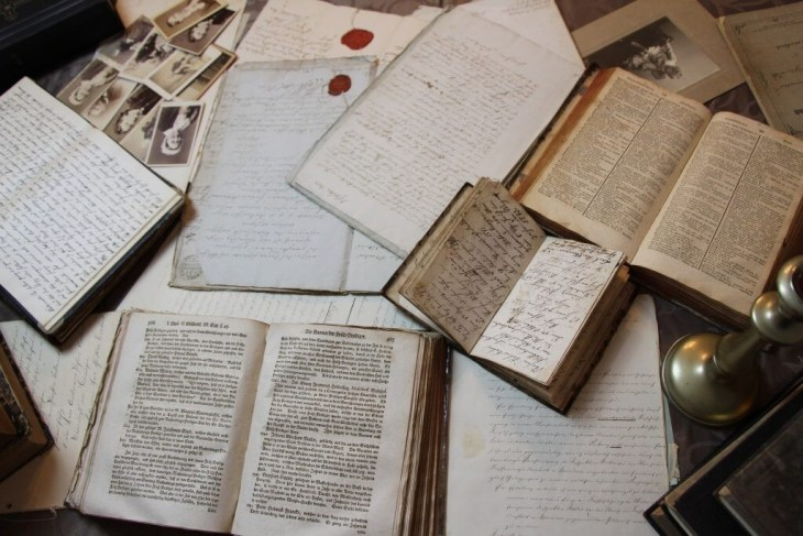 vintage journals laying on the table