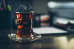hot black tea inside a glass