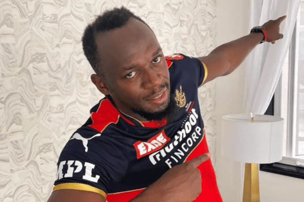 IPL 2021   'Fastest athlete in the world' Usain Bolt wears RCB Jersey   Virat Kohli and AB de Villiers react