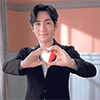Zhu Yilong making *heart* hands