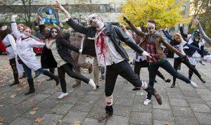 People dance in a zombie walk during Halloween celebrations in Berlin, Germany, October 31, 2015. REUTERS/Hannibal Hanschke - RTX1U54V