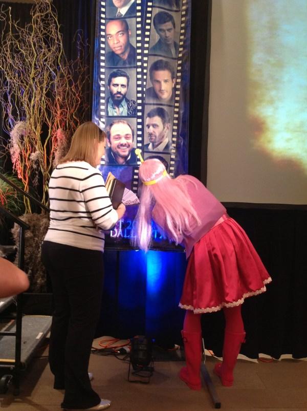 Princess Bubblegum signs the con banner