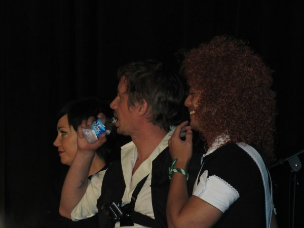 Kim, Chad and Osric sing karaoke backup
