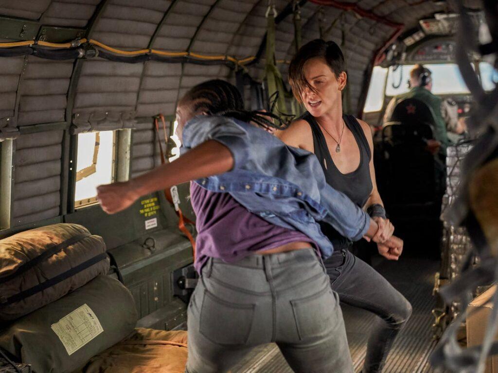 Charlize Theron punching Kiki Layne in plane