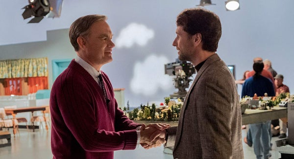 Tom Hanks shaking hands with Matthew Rhys in A Beautiful Day in the Neighborhood