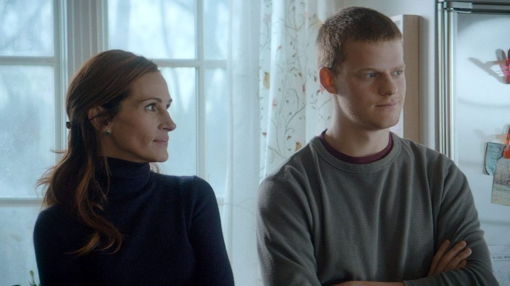 Lucas Hedges and Julia Roberts standing together in Ben is Back