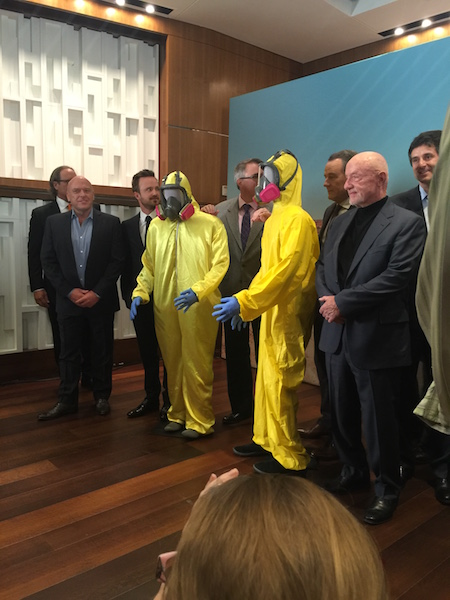 Cast of Breaking Bad with yellow hazmat suits at Smithsonian