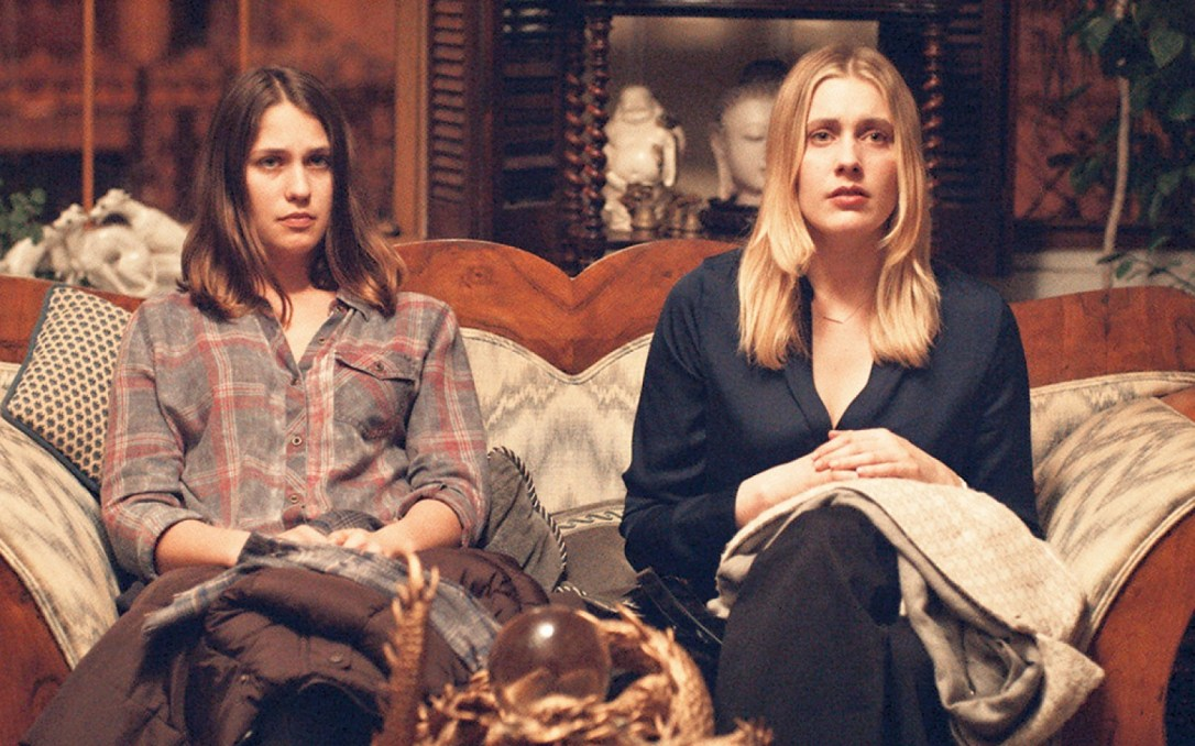Lola Kirke and Greta Gerwig sitting together on a couch in Mistress America