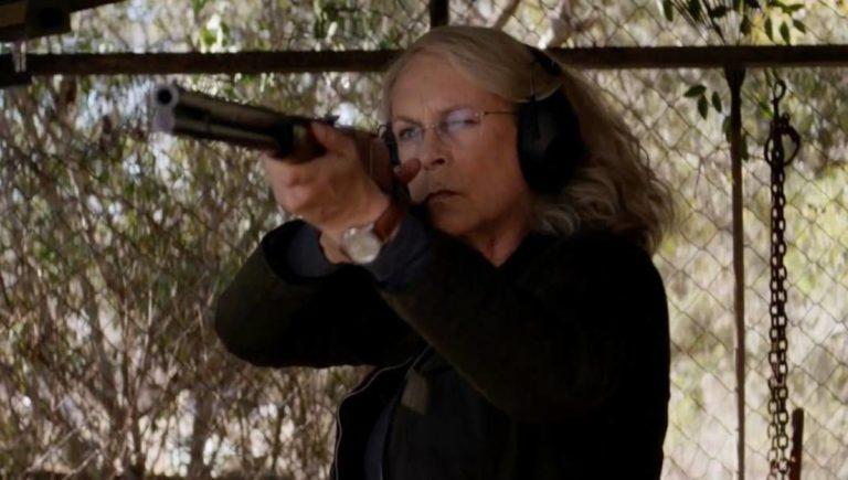 Jamie Lee Curtis shooting shotgun in Halloween
