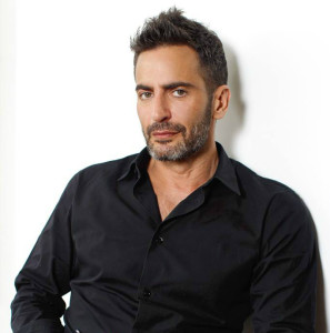 Designer Marc Jacobs standing in front of a white background