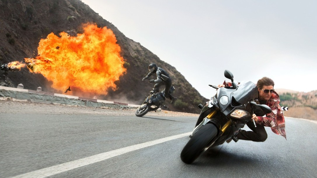 ethan hunt (tom cruise) and ilsa faust (rebecca ferguson) motorcycle in mission impossible rogue nation