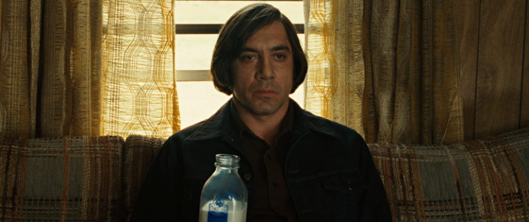 Javier Bardem with a bad haircut staring blankly in No Country for Old Men
