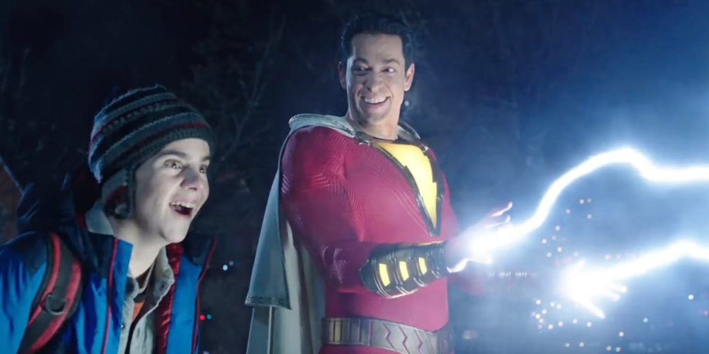Zachary Levi as Shazam shooting lightning out of his fingers with Jack Dylan Grazer