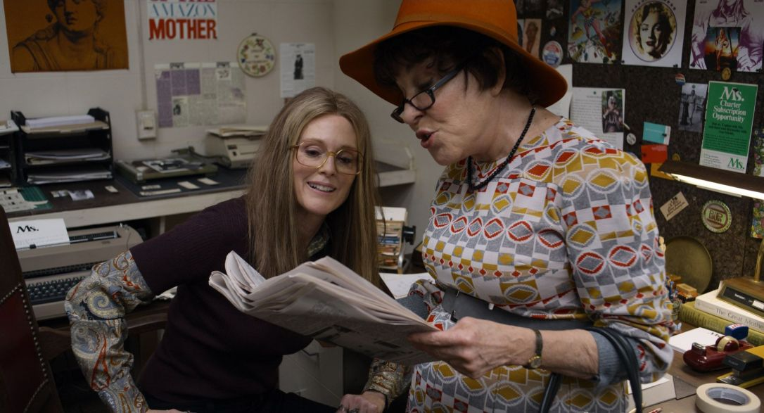 Julianne Moore and Bette Midler looking at Ms. Magazine in The Glorias