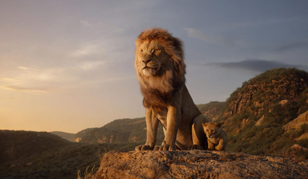 mufasa and baby simba standing on a  hill in Disney's The Lion King