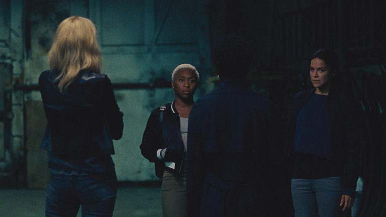 cynthia erivo, elizabeth debicki, and viola davis talking in Widows movie