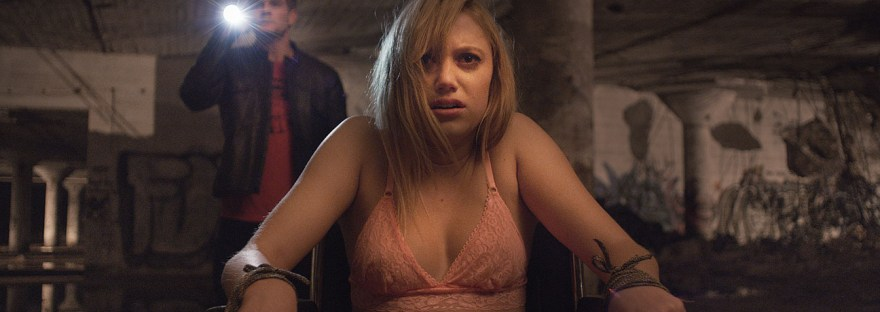 Maika Monroe tied to chair in It Follows