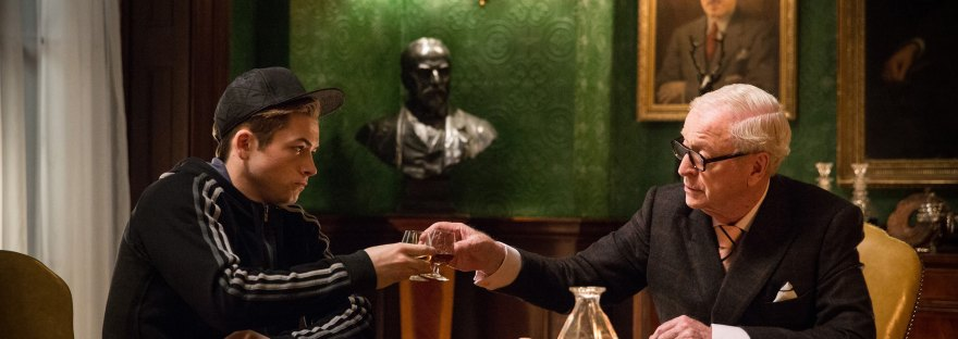 Michael Caine and Taron Egerton cheers in Kingsman