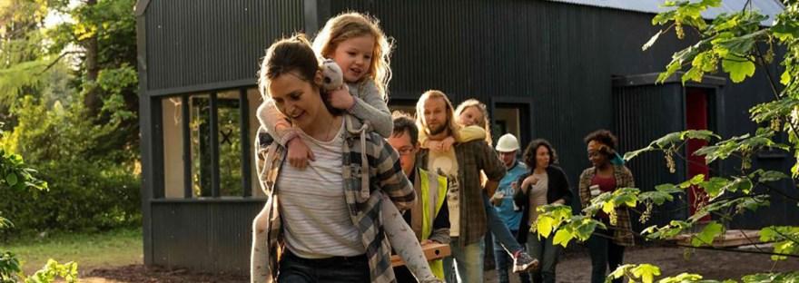 Clare Dunne with kid piggyback in Herself movie