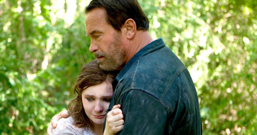 Abigail Breslin hugging in Arnold Schwarzenegger's in Maggie