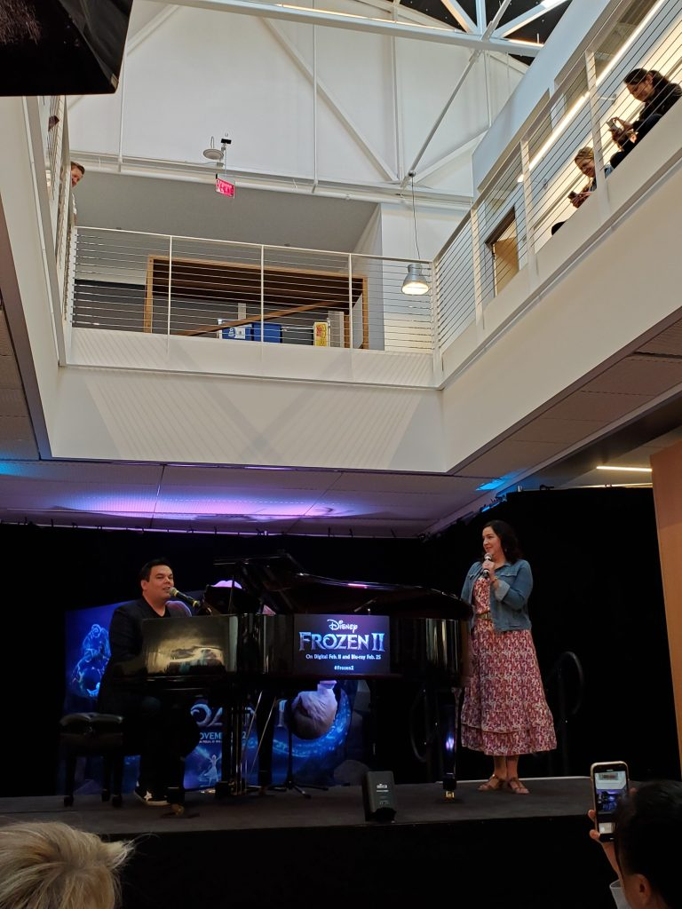 Kristen Anderson-Lopez and Bobby Lopez performing a medley of songs from Frozen II