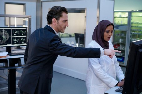 BLINDSPOT -- Pictured: (l-r) Aaron Abrams as Matthew Weitz, Ami Sheth as Afreen -- (Photo by: Myles Aronowitz/Warner Brothers/NBC)