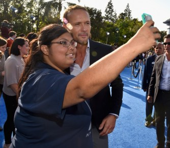 "ANAHEIM, CA - MAY 09: Singer Tim McGraw takes a selfie with a fan during the world premiere of Disney's ""Tomorrowland"" at Disneyland, Anaheim on May 9, 2015 in Anaheim, California. (Photo by Alberto E. Rodriguez/Getty Images for Disney) *** Local Caption *** Tim McGraw"