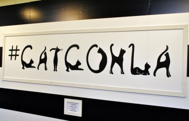 CatConLA hand painted sign with cats as letters