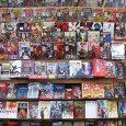 Person looking at large comic book rack
