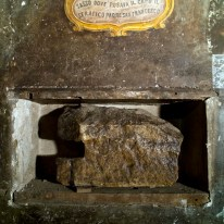 """A stone believed to be used by St. Francis of Assisi as a pillow is on display in a cell of the convent of St. Francesco a Ripa in Rome, Friday, Feb. 28, 2014, that he is believed to have visited on the occasion of his trips to the city. The inscription reads in Italian: """"Stone where the Serafic Father St. Francis would rest his head"""". The friars who run the St. Francis a Ripa church in Rome's Trastevere neighborhood are launching a Kickstarter online fundraising campaign Tuesday, March 11, 2014, to try to raise the $125,000 to restore the tiny cell upstairs from the sacristy where St. Francis stayed, The Associated Press has learned. Rather than ask for funding from the Italian government, which owns the church and is responsible for its upkeep, the friars decided on this more democratic crowdfunding initiative thinking it more in keeping with the Franciscan tradition of seeking alms for just what they need, spreading the faith as they beg, and making sure the poor are the priority. (AP Photo/Domenico Stinellis)"""