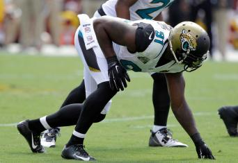 Jacksonville Jaguars defensive end Chris Clemons (91) is in his stance at the line of scrimmage during the first half of an NFL football game against the Washington Redskins Sunday, Sept. 14, 2014, in Landover, Md. (AP Photo/Mark E. Tenally)