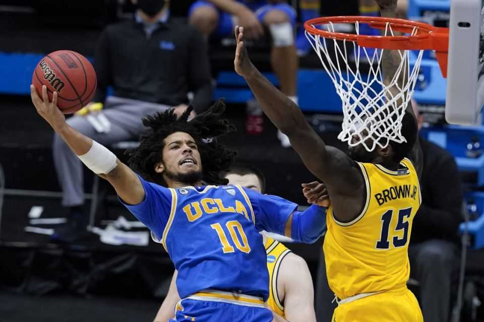 UCLA guard Tyger Campbell shoots over Michigan guard Chaundee Brown during the Bruins' Elite Eight win Tuesday.