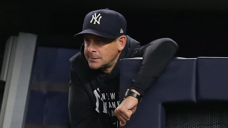 Aaron Boone looks out from dugout