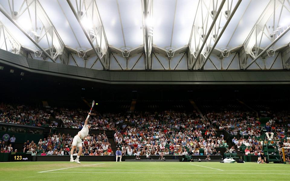 Murray serves under the roof - GETTY IMAGES