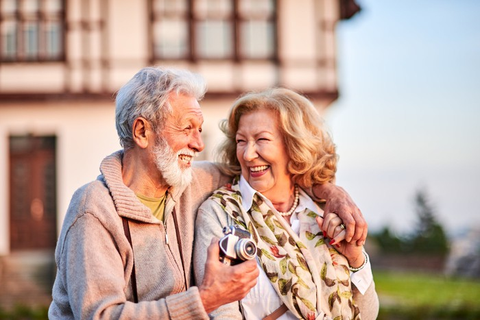 A senior couple in the countryside.