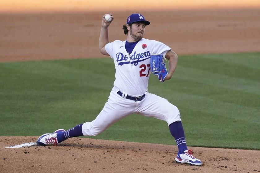 Los Angeles Dodgers starting pitcher Trevor Bauer (27) throws during the first inning.