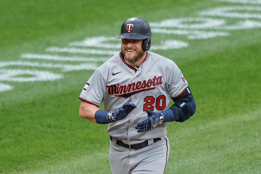 Josh Donaldson with Twins smiles while rounding bases on homer 2021